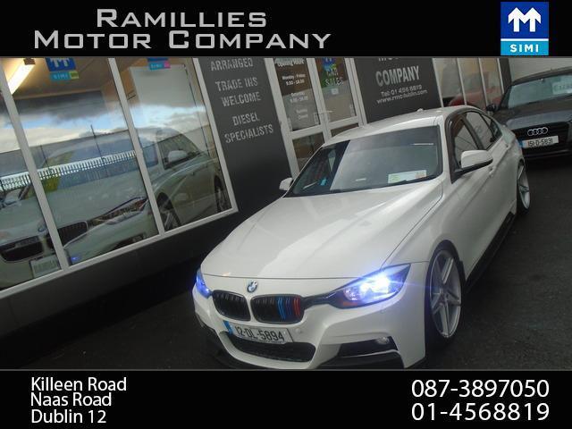 2012 BMW 3 Series - Image 1